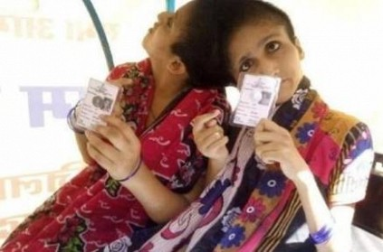 Conjoined sisters cast their votes with independent voting rights