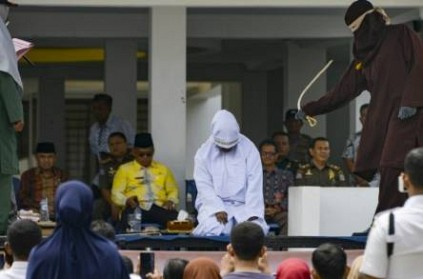Couples flogged for public affection in Indonesia's Aceh